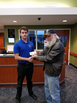 Toby receives award from Preisdent Miller